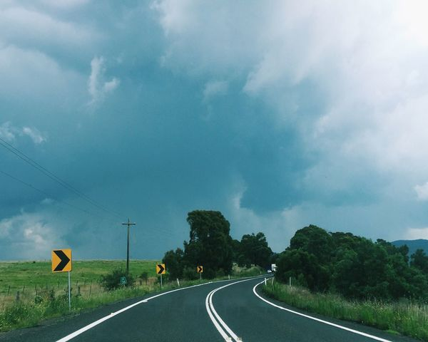 Storms on a winding road Transportation Road Tree The Way Forward Road Marking Landscape Sky Long Cloud Countryside Road Sign Country Road Tranquil Scene Empty Solitude Pole Cloud - Sky Day Diminishing Perspective Dividing Line Driving Joy Ride Storm Storm Chasing Blue Mountains