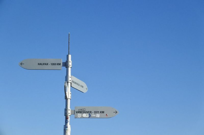 a pole in toronto2 Directional Sign S Sign Blue Blue Sky Clear Sky Communication Day Direction Directions Guidance Low Angle View No People Outdoors Pole Road Sign Sky Street Name Sign Text Wallpaper White Background かなd サイン 標識 空