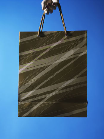 Free Time Holiday Season Icon Paper Bag Blue Consumerism Expenses Hanging Leisure Activity Luxury Paper Retail  Shopping Bag Spending Symbol