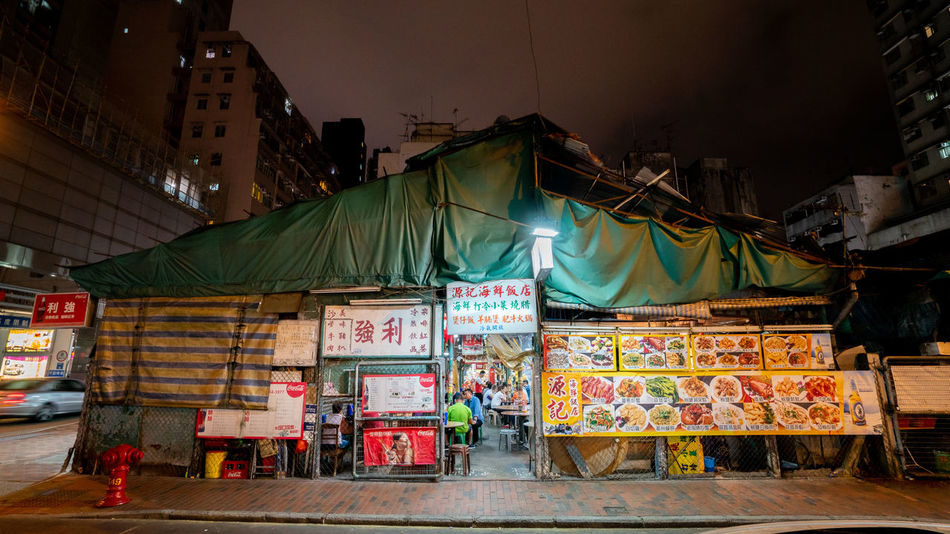 Temple Street in Hong Kong Hong Kong Temple Street Tree Streetphotography Night View Food Court Food Store Restaraunt People
