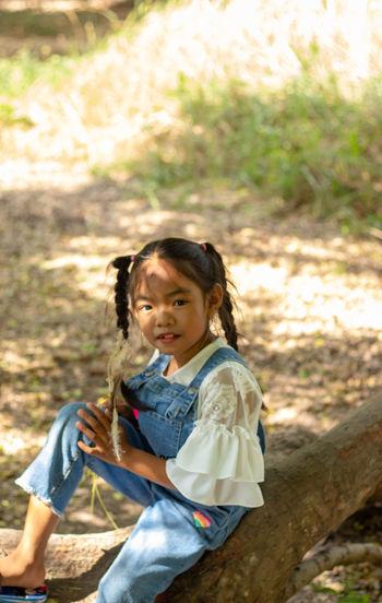 Portrait of cute girl on land