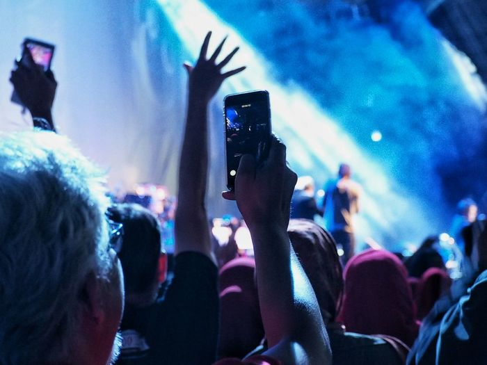 Man Photographing Performance At Music Concert