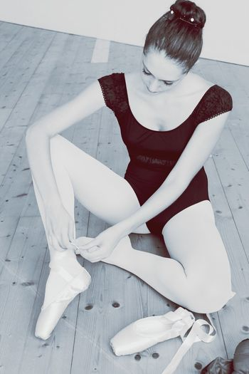 Ballet Ballet Dancer Young Adult One Person Young Women Full Length Beautiful Woman Beauty Hair Bun Indoors  Sitting Beautiful People Real People Legs Apart Portrait One Young Woman Only Day Adult People Balletdancer Pointe Shoes EyeEmNewHere Eye4black&white