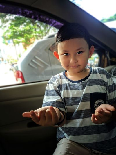 Portrait of boy in car