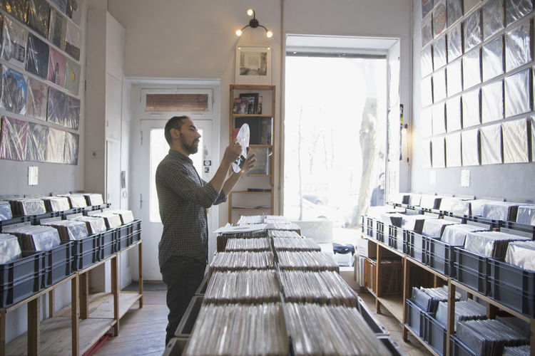 Young man shopping for records