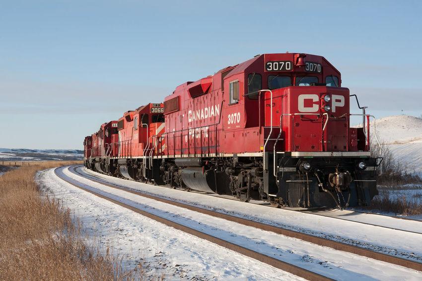 CP Rail locomotives, north of Regina Canada Canadian Pacific Rail Cp CP Rail Diesel Locomotive Outdoors Prairie Prairie Scenes Rail Rail Transportation Railroad Railroad Track Railway Red Regina Saskatchewan Snow Train Transportation Winter
