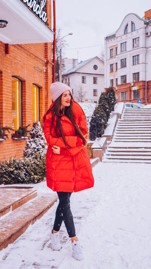 Full Length Of Woman Standing In City During Winter