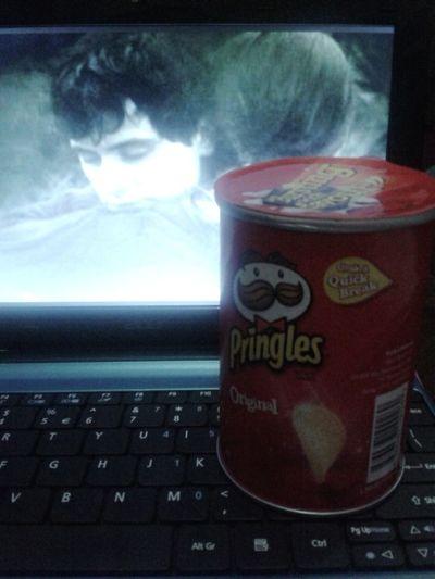 Munching Pringles while Watching A Movie Relaxing Taking Photos Enjoying Life