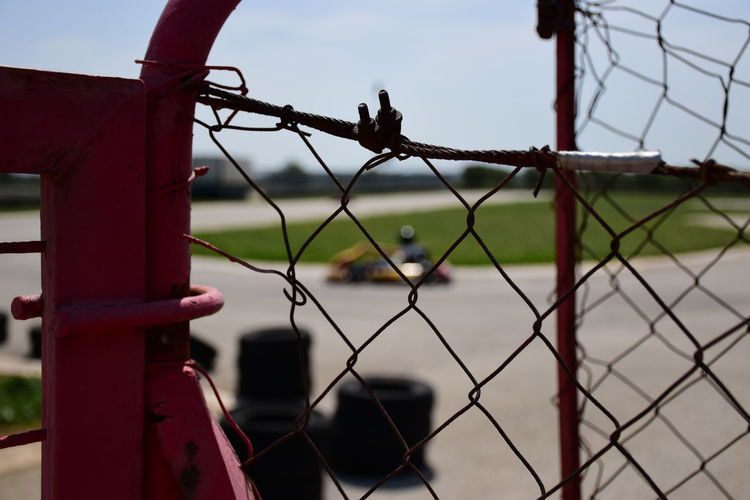 Kart Gokart Kids Being Kids Kartodromo Race Motorsport Fast Kids Playing Son Nikon Nikonphotography Nikon D5500 Prison City Military Sport Razor Wire Barbed Wire Protection Prisoner Exclusion Safety Chainlink Chainlink Fence Playing Field Confined Space Wire Mesh Boundary Adventures In The City