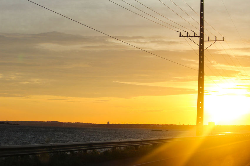 Sol se ponto Sol Nascer Do Sol Sunset Cable Connection Transportation Electricity Pylon Fuel And Power Generation Orange Color Power Supply Nature No People Outdoors Technology Electricity  Scenics Cloud - Sky Silhouette Power Line  Sun Beauty In Nature Sky Day