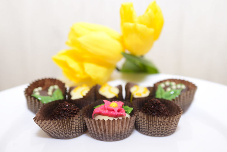 Close-up of cupcakes against white wall