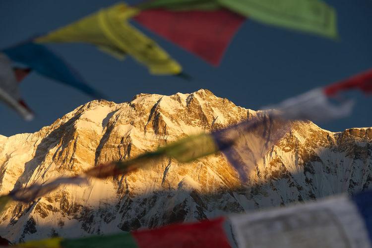 Close-up of tibetan flag on mountain