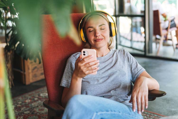 Portrait of teenage girl sitting on mobile phone