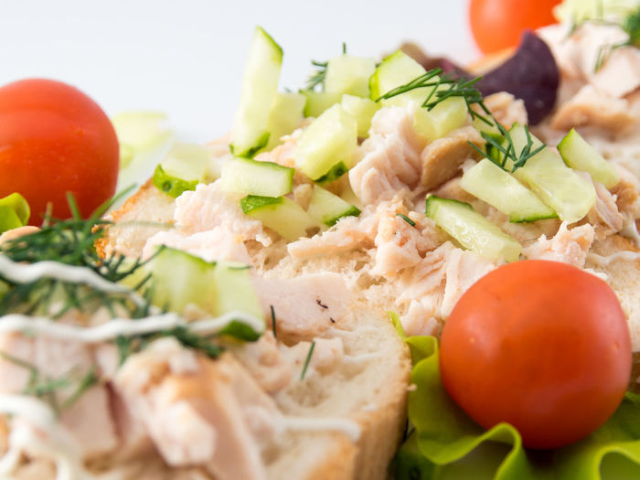 Bread with smoked chicken, tomatoes and cucumber. Close-up Cucumber Day Food Food And Drink Fresh Freshness Healthy Eating Indoors  No People Plate Ready-to-eat Selective Focus Serving Size Smocked Tasty Tomato Tomatoes Vegetable