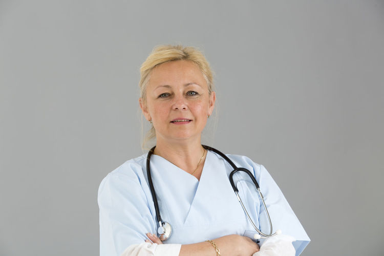 Posing Reassuring Reassure Trust Self Confidence Self Confident Selfconfident Crossed Arms Front View Looking To The Camera Looking At CameraReassurance Clinic White Background Hospital Doctor  Doctor  Nurse Medical Pediatrics Pediatrician Smiling Stethoscope  Portrait Beautiful Woman