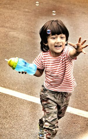 You're never too old, too wacky, too wild to chase and burst a bubble! Childhood Child People One Person Happiness Cute Playing Smiling Boys Outdoors Day Beautiful Bubble Bubbles Kid Kids Being Kids Catch Catching Bubbles
