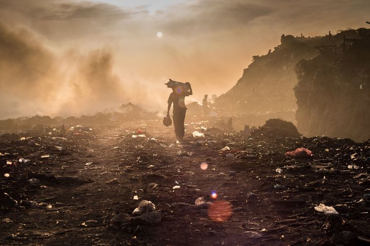 Man walking at landfill