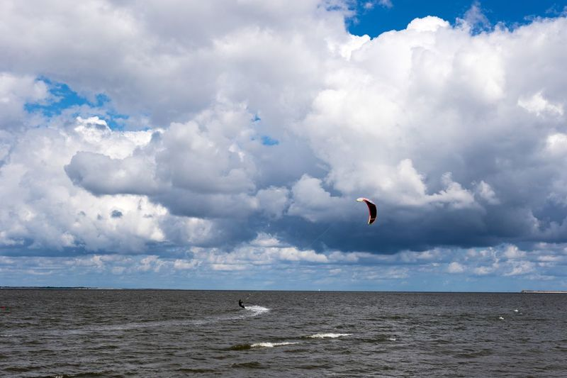 Neuharlingersiel, North Germany Sky Cloud - Sky Sea Nature Adventure Parachute Horizon Over Water Extreme Sports Scenics Day Outdoors Leisure Activity Beauty In Nature Water Beach Tranquility Tranquil Scene Mid-air Real People Vacations Kitesurfing Kite