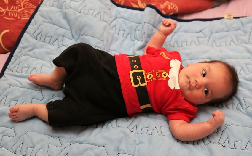 Baby Boy in Santa Claus Costume Bed Childhood Baby Child Full Length Young Lying Down Babyhood Innocence Cute Indoors  High Angle View Lying On Back Baby Boy Santa Claus Costume Santa Claus Santa Claus Is Coming To Town  Baby Costume