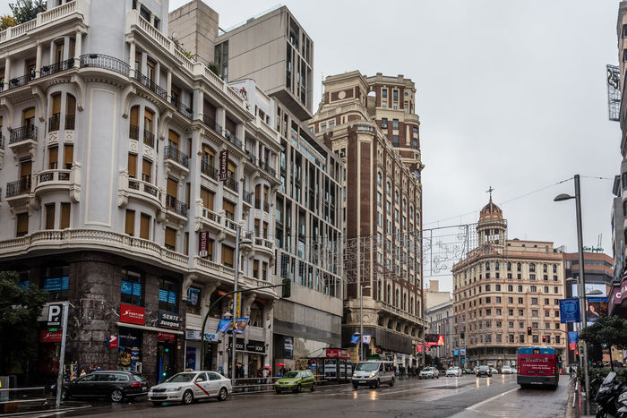 Gran Via Avenue in Madrid a rainy day Architecture Building Exterior City City City Break City Life City Street Cityscape Cityscape Commercial Day Europe Gran Via Madrid Outdoors People Perspective Police Station Rainy SPAIN Street Theaters Travel Destinations Urban Urban Landscape
