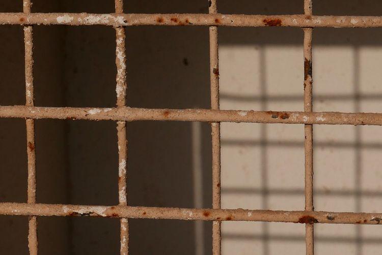 Full Frame Shot Of Rusty Metal Grate Window