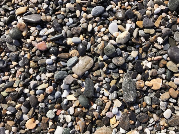 Beach stones at surf Abundance Backgrounds Beach Beauty In Nature Close-up Day Full Frame Large Group Of Objects Nature No People Outdoors Pebble Pebble Beach Shore
