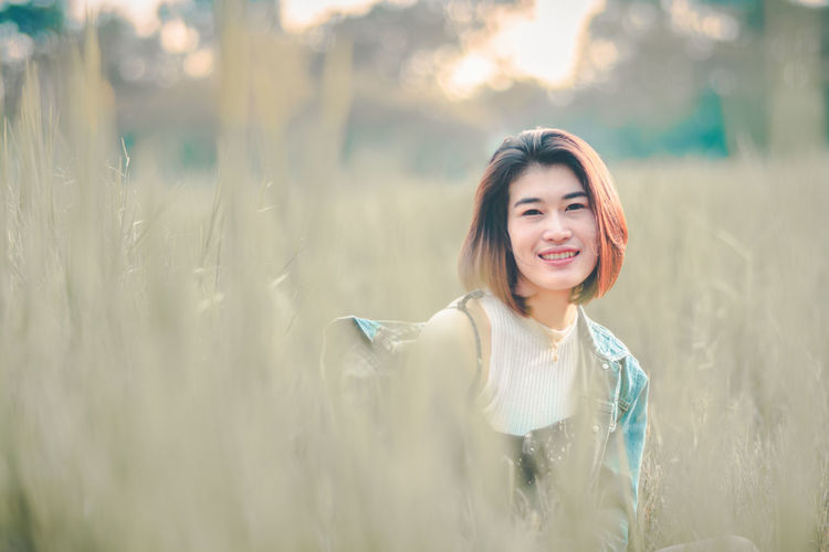 Beautiful Woman Beauty Front View Hair Hairstyle Happiness Land Leisure Activity Lifestyles Looking At Camera One Person Outdoors Portrait Real People Smiling Women Young Adult Young Women