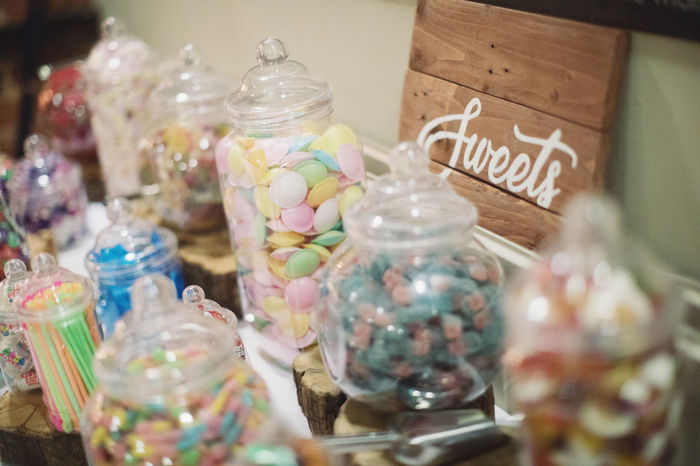 Candy jars on a table Sweet Food Glass - Material Food Sweet Indoors  Choice Transparent Food And Drink Indulgence No People Candy Still Life Multi Colored Variation Temptation Close-up Selective Focus Jar Container Large Group Of Objects Sale Glass