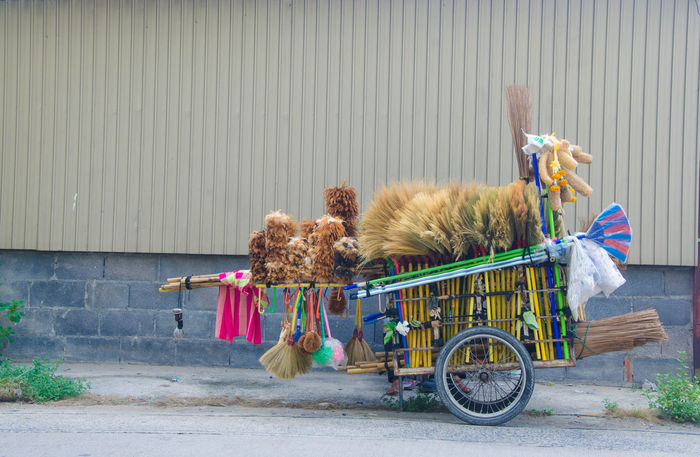 Asian Cart of cleaning mops, brooms, wooden feather handmade parked in preparation for sale and people are taken to the cleaners. Asian  Asian Culture Brooms  Sale Cart Cleaning Mops No People Outdoors Transportation Funny Funny Pics Strange Things Strange Odd Whimsical Uncommon  Antic Quizzical Freakish Unaccustomed