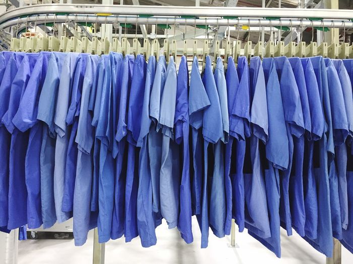 Industrial Hanging Blue No People Textile Clothing Store Large Group Of Objects In A Row Side By Side Indoors  For Sale Business Rack Abundance Business Finance And Industry Retail  Day Choice Drying Fashion