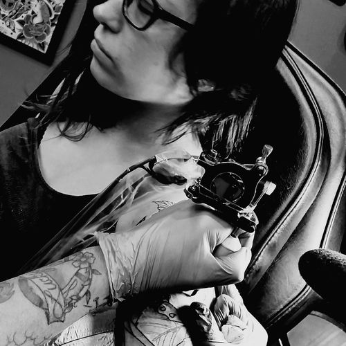 My daughter getting her first ink