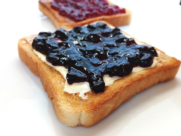 delicious toast with butter blueberry and strawberry jam Blueberry Jam Sweet Delicious Tasty Chrunchy Crusty Morning Breakfast Sunday Morning White Background Toasted Bread Breakfast Bread French Food Dessert Close-up Sweet Food Food And Drink Sliced Bread Jam Toast White Bread Butter Strawberry Jam