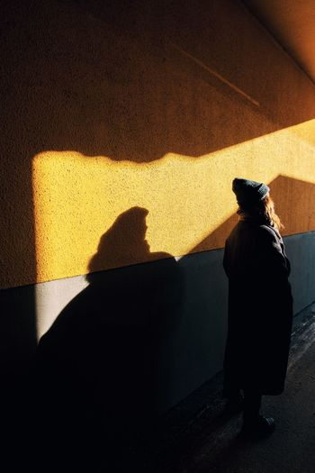 Shadow of man and woman walking on wall