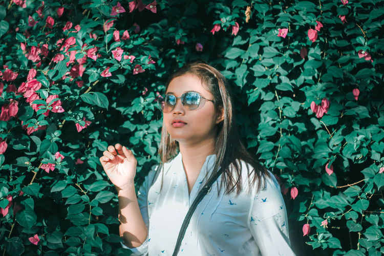 Plant One Person Real People Young Adult Lifestyles Leisure Activity Glasses Growth Flower Flowering Plant Nature Young Women Plant Part Leaf Beauty Day Portrait Standing Vulnerability  Hair Beautiful Woman Hairstyle Outdoors Contemplation My Best Photo