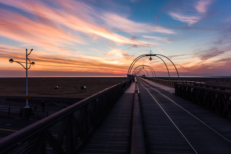 Southport Pier Over Beach Against Sky During Sunset