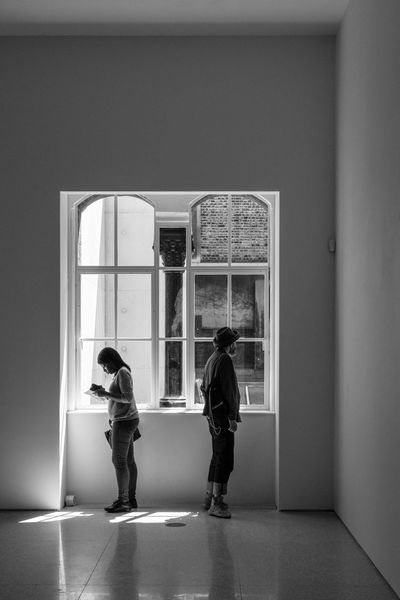 Together Alone. Street Photography Streetphoto_bw Streetphotography Street Photo LONDON❤ London Malephotographerofthemonth Full Length Women Standing Rear View Looking Through Window Togetherness Window Door Art Museum Museum