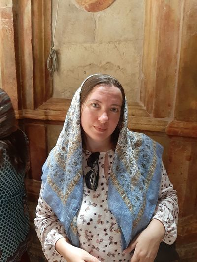 Portrait of mature woman wearing headscarf while standing in church