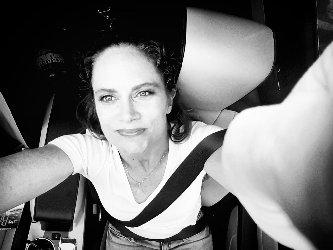 High Angle View Of Smiling Mid Adult Woman With Arms Raised Sitting In Car