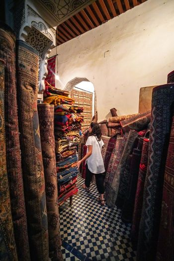 Carpet entry EyeEmNewHere Digital Nomad Travel Destinations Travel Photography Morroco Fes Morocco Choice Retail  Variation Clothing One Person Women Adult For Sale Shopping Full Length Real People Store Indoors  Market Large Group Of Objects Fashion Hanging Standing Lifestyles Retail Display Sale Consumerism