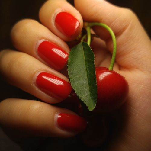 Human Body Part Human Hand Human Finger Nail Polish Beauty Red Fingernail Close-up Holding Indoors  Manicure Cherry