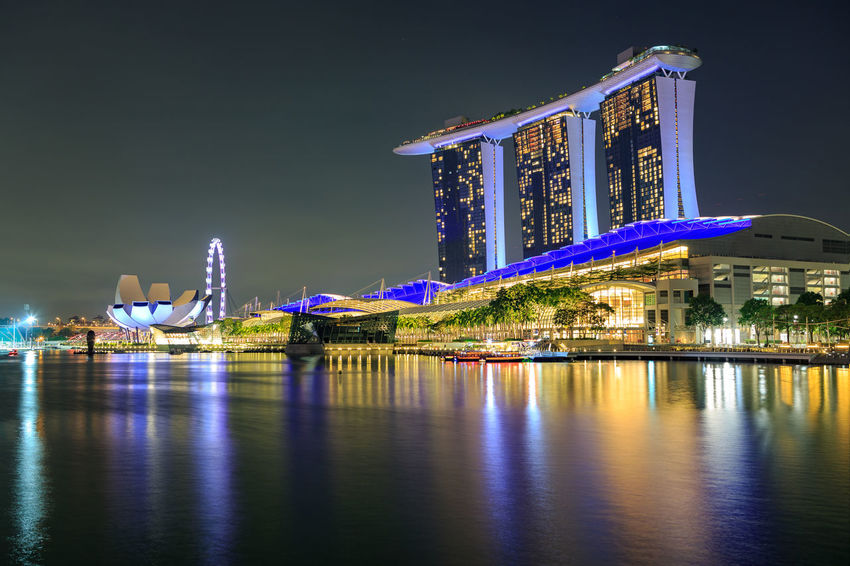 Marina Bay Sands Hotel of Singapore town by night, Singapore. Asian Culture City, Marina Bay Sands Hotel, Panorama, Singapore, Architecture, Asia, Bay, Building, Business, Cityscape, District, Dusk, East, Evening, Famous, Hotel, Illuminated, Landmark, Landscape, Light, Marina, Modern, Night, Reflection, Sea, Skyline, Skyscrapers, Singapore Architecture Arts Culture And Entertainment Building Exterior Built Structure City Cityscape Illuminated Luxury Hotel Night No People Outdoors Reflection Sky Tourism Travel Travel Destinations Urban Skyline Water Waterfront