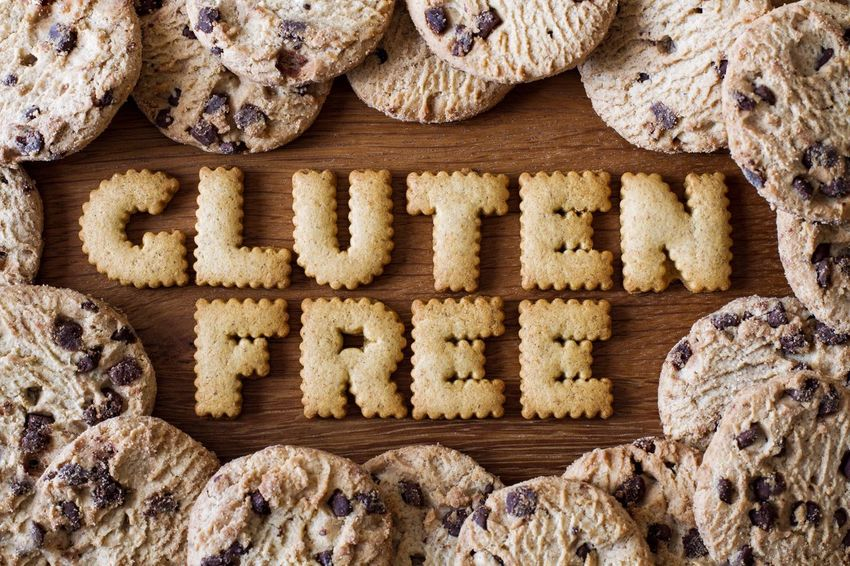 The phrase Gluten Free created from alphabet shaped cookies and surrounded by chocolate chip biscuits on a wooden background. Gluten Free Glutenfree Glutenfrei Cookie Directly Above Food Healthy Eating Words Wooden Background Advice Bakery Sweet Food Food And Drink Healthy Lifestyle Healthy Food GlutenFreeFood Wooden Gluten Alphabet Food Advice Healthy Baking Cookies Biscuits Baked Food Stories