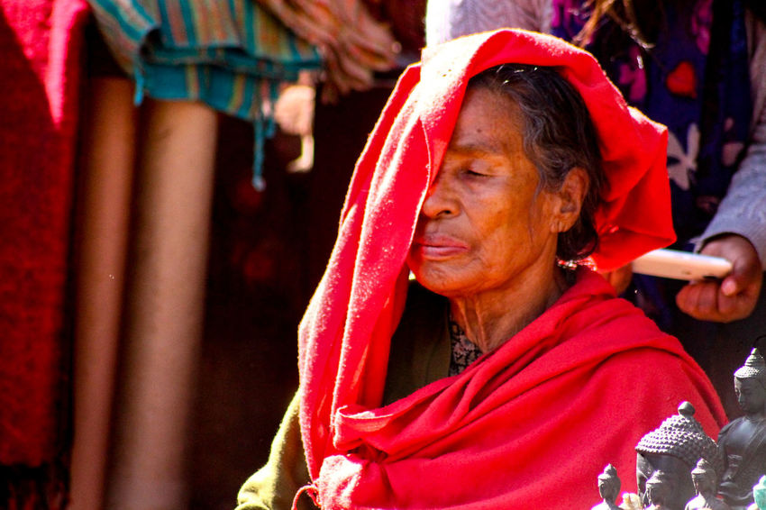 Portrait Of A Woman Old Woman Cultures Red Real People Adults Only People Sari Bangle Holi One Woman Only One Person Religion Travel Photography Travel EyeEm Best Shots Kathmandu, Nepal Thamel Street Traditional Clothing Street Photography People Photography Zen Calm The Portraitist - 2017 EyeEm Awards