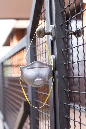 Close-up of chain hanging on fence