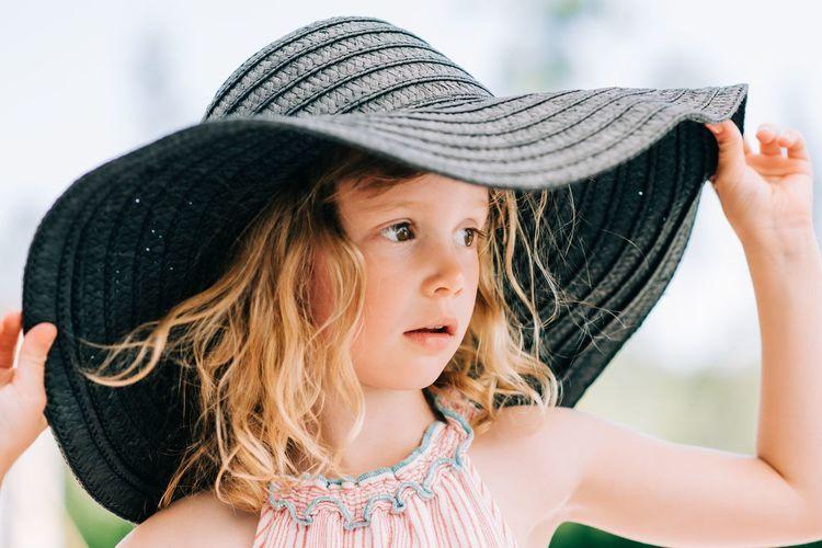 Portrait of cute girl wearing hat
