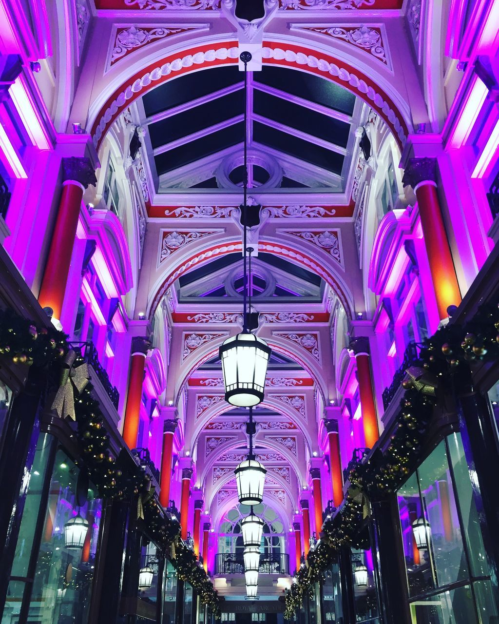 architecture, ceiling, built structure, indoors, arch, purple, hanging, low angle view, multi colored, illuminated, the way forward, no people, day