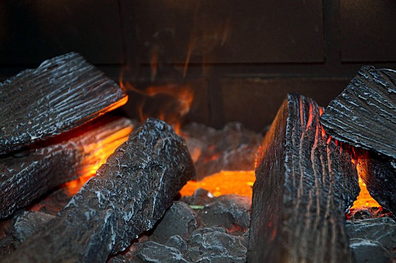 Close-Up Of Firewood At Fireplace