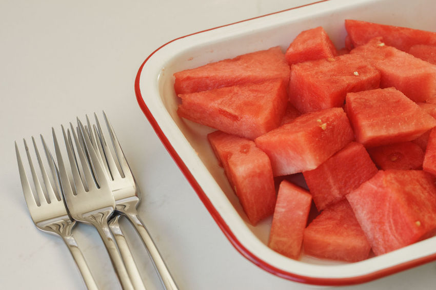 Watermelon in a bowl with multiple forks. Melons Summer Fruits Bowl Close-up Food Food And Drink Fork Forks Freshness Healthy Eating Indoors  No People Plate Ready-to-eat Red Refreshing SLICE Still Life Summer Fruit Watermelon