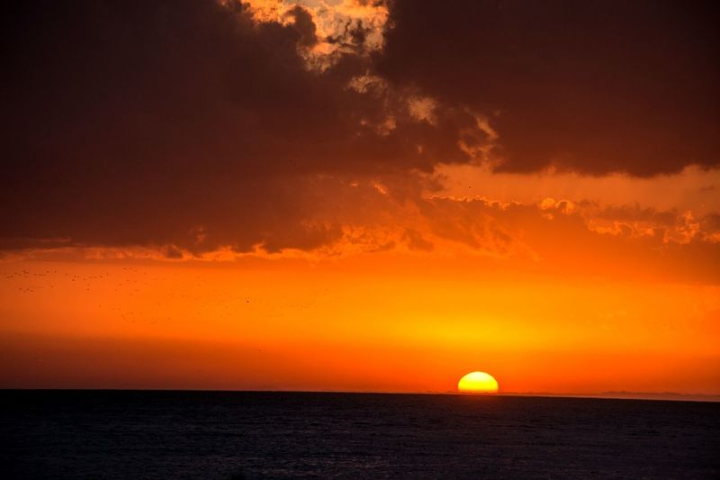 Sunset Orange Color Dramatic Sky Sun Sea Horizon Nature Travel Destinations Beauty In Nature Outdoors Silhouette Horizon Over Water Scenics Vacations Travel No People Sky Heat - Temperature Tranquility Landscape