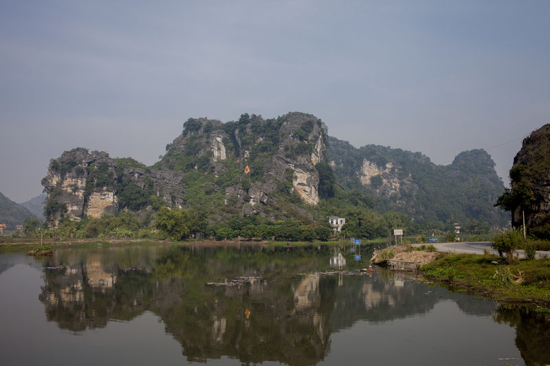 Reflection Of Rocky Mountains On River At Halong Bay